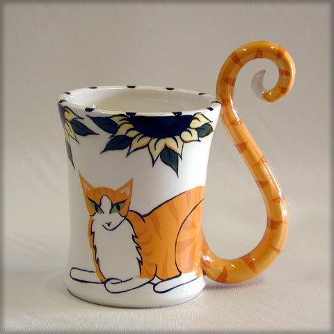 http://www.catfancygifts.com/productthumbs/CoffeeC/OrangeTabbyLaying1.jpg